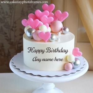 Happy birthday cake with little pink hearts